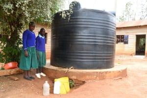 The Water Project: Migwani DEB Primary School Rain Tank -  Students At Small Water Tank
