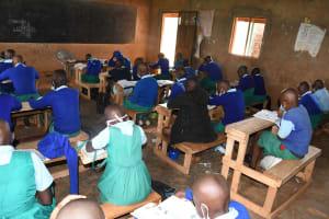 The Water Project: Migwani DEB Primary School Rain Tank -  Studying