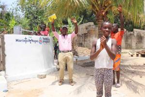 The Water Project: Kamasondo, Masinneh Village -  Community Members Celebrating