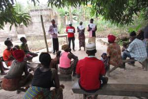 The Water Project: Kamasondo, Masinneh Village -  Participants Display Training Posters