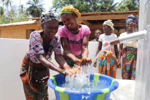 The Water Project: Kamasondo, Masinneh Village -  Splashing Water From The Well