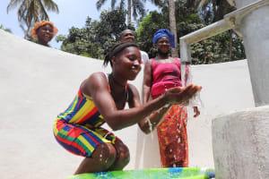 The Water Project: Lokomasama, Bompa Morie Village -  Girl Splashing Water