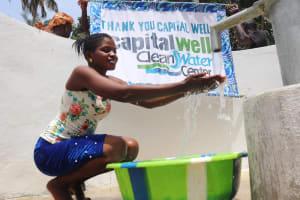 The Water Project: Lokomasama, Bompa Morie Village -  Girl Splashing With Banner
