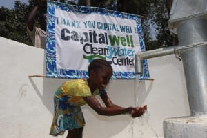 The Water Project: Lokomasama, Bompa Morie Village -  Kid Looking At Clean Water Flowing