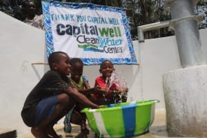 The Water Project: Lokomasama, Bompa Morie Village -  Kids At The Well With Banner