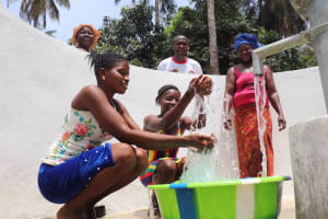 The Water Project: Lokomasama, Bompa Morie Village -  Kids Splash Water From The Well