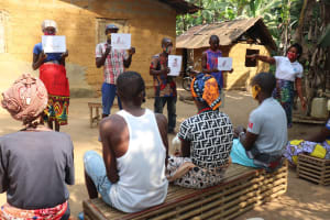 The Water Project: Lokomasama, Bompa Morie Village -  People Hold Up Posters