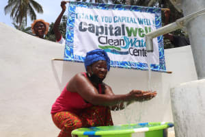 The Water Project: Lokomasama, Bompa Morie Village -  Woman At The Well With Banner