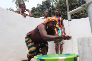 The Water Project: Lokomasama, Bompa Morie Village -  Woman Drinks From The Well