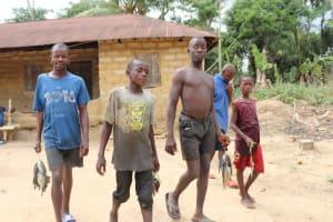 The Water Project: Kamasondo, Bross 1 -  Returning Home From Fishing