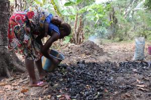 The Water Project: Kamasondo, Bross 1 -  Processing Charcoal
