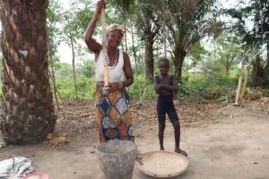 The Water Project: Kamasondo, Bross 1 -  Woman Pounding Rice