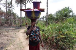 The Water Project: Kamasondo, Bross 1 -  Woman Carrying Laundry