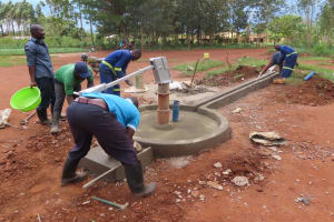 The Water Project: Marongo-Kahembe Community -  Constructing The Well Apron And Drainage Channel