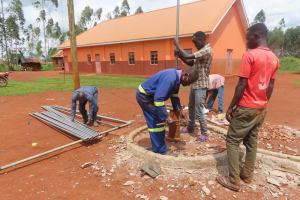 The Water Project: Marongo-Kahembe Community -  Installing New Pipes For Well