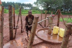 The Water Project: Marongo-Kahembe Community -  Mwesigwa M Pumps The Well
