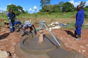 The Water Project: Rwenziramire Community -  Cement Work On The Well Apron