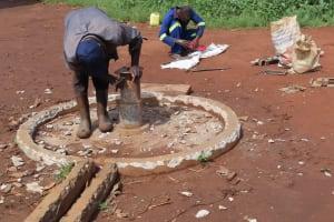 The Water Project: Rwenziramire Community -  Demolishing The Old Well Apron
