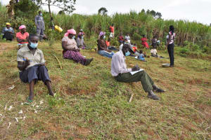 The Water Project: Indulusia Community, Wanyama Spring -  Community Members Take Notes At Training
