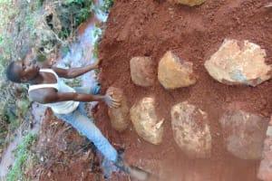 The Water Project: Shikoye Community, Kwa Witinga Spring -  Stone Pitching