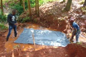 The Water Project: Shikoye Community, Kwa Witinga Spring -  Foundation Plastic Sheet
