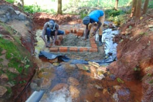 The Water Project: Shikoye Community, Kwa Witinga Spring -  Brick Setting