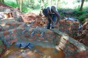 The Water Project: Shikoye Community, Kwa Witinga Spring -  Wall Construction