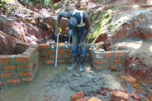 The Water Project: Shikoye Community, Kwa Witinga Spring -  Pipe Setting