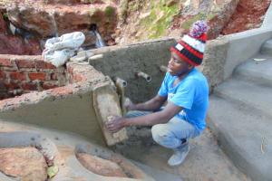 The Water Project: Shikoye Community, Kwa Witinga Spring -  Outside Plastering