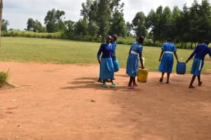 The Water Project: Ingavira Primary School -  Pupils Carrying Water