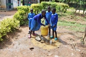 The Water Project: Ingavira Primary School -  Pupils Fetching Water