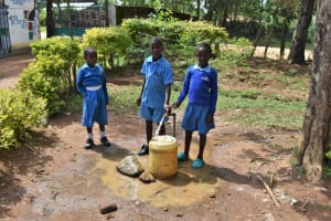 The Water Project: Ingavira Primary School -  Pupils Fetching Water From Pipe