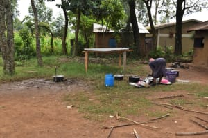 The Water Project: Ingavira Primary School -  The Chef Cleaning Cutlery