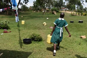 The Water Project: Mali Mali Primary School -  Pupil Ferrying Water To School