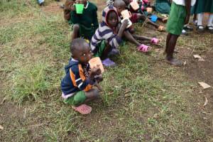 The Water Project: Mali Mali Primary School -  Pupils Taking Porridge