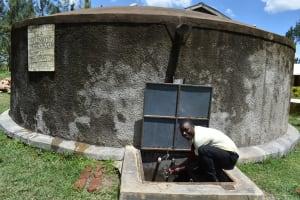 The Water Project: St. Gerald Mayuge Secondary School -  Student Benjamin Splashing Water
