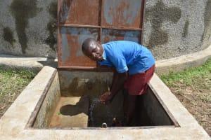 The Water Project: St. Michael Mukongolo Primary School -  Samwel Splashing Water