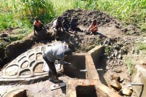 The Water Project: Shianda Community, Akhonya Spring -  Outside Plastering