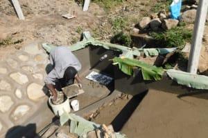 The Water Project: Shianda Community, Akhonya Spring -  Tile Setting