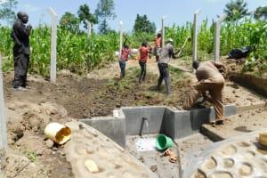 The Water Project: Shianda Community, Akhonya Spring -  Backfilling With Soil
