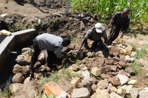 The Water Project: Shianda Community, Akhonya Spring -  Backfilling With Stones