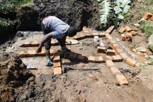 The Water Project: Shianda Community, Akhonya Spring -  Brick Setting