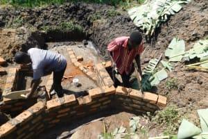 The Water Project: Shianda Community, Akhonya Spring -  Raising The Wall