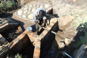 The Water Project: Shianda Community, Akhonya Spring -  Setting The Discharge Pipe