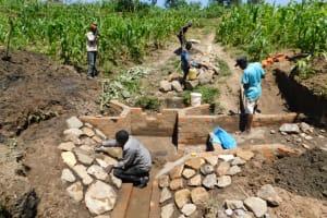 The Water Project: Shianda Community, Akhonya Spring -  Stone Pitching