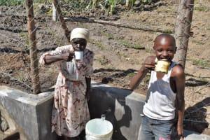 The Water Project: Shianda Community, Akhonya Spring -  Community Members Celebrating