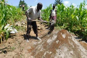 The Water Project: Shianda Community, Akhonya Spring -  Community Mixing Cement