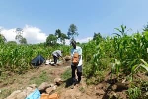The Water Project: Shianda Community, Akhonya Spring -  Community Moving Bricks