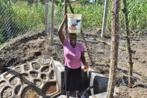 The Water Project: Shianda Community, Akhonya Spring -  Jackline Leaving With Water