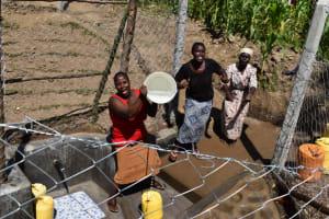 The Water Project: Shianda Community, Akhonya Spring -  Using Akhonya Spring